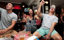 Ed Newaly from massachusetts, Heather Newaly from Hawaii and Keawe Holt from Hawaii watching the superbowl final at shakespeare bar (Auckland)