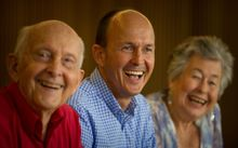 Australian journalist Peter Greste's father Juris Greste, left, brother Andrew Greste and mother Lois Greste celebrate his release.