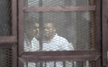 Some of 183 people who were sentenced to death after being found guilty of killing 11 policemen are seen in glass cages at the Tora Prison in Cairo, Egypt on February 02, 2015.