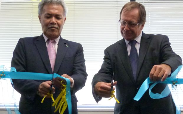 Tuvalu's Prime Minister, Enele Sopoaga, and New Zealand's Foreign Minister, Murray McCully, cut the ribbon to open Tuvalu's High Commission in Wellington