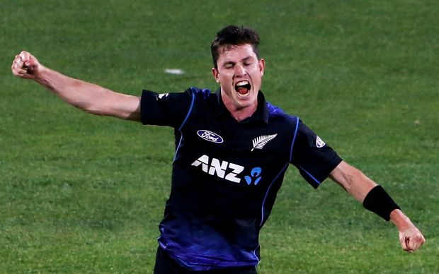 The Black Caps fast bowler Adam Milne celebrates taking a wicket.