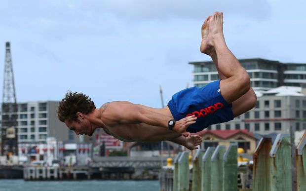 Gillies Kaka takes the plunge into Wellington Harbour.