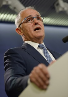 Australia's Communications Minister Malcolm Turnbull speaks at a press conference in Sydney on September 24, 2013.
