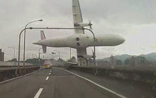A TransAsia Airways plane clipped a bridge and crashed into a river near the capital, Taipei.