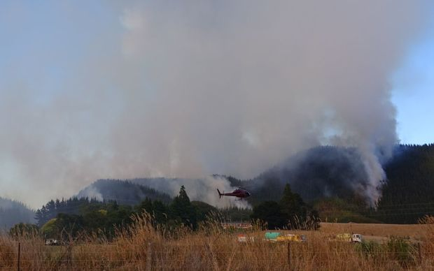 Fire fighters, helicopters and planes are battling a fire west of Blenheim.