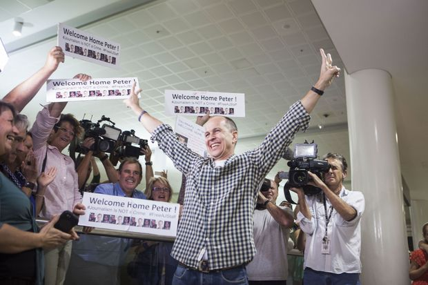Al Jazeera journalist Peter Greste is warmly greeted by friends, family and media at Brisbane airport on February 5, 2015.