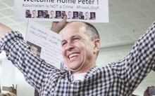 Al Jazeera journalist Peter Greste is warmly greeted by friends, family and media at Brisbane airport on February 5, 2015