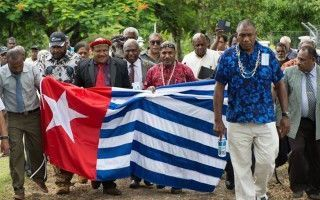 The United Liberation Movement for West Papua converges on the Melanesian Spearhead Group secretariat.