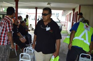 A Tongan Red Cross officer leads a mosquito cleanup operation to combat dengue fever.