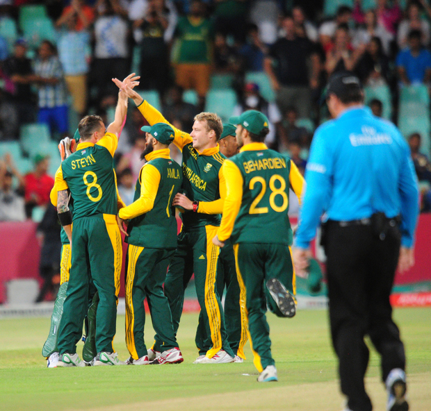 South Africa celebrate a wicket against West Indies on 16 January in Durban.