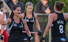The Black Sticks women celebrate a goal.