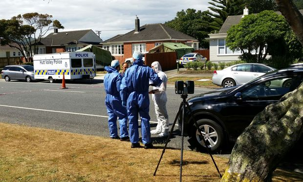 Police and forensic investigators at the scene in Taita on Friday.