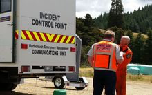 Richard McNamara and Rich Law, from the Blenheim rural fire force, in front of the incident control point.