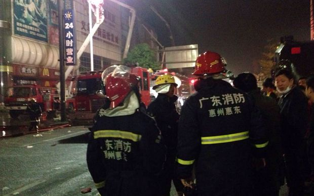Chinese firefighters at the site after a fire killed over 17 people in a warehouse in South China's Guangdong province.