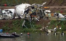 Divers searching the Keelung river next to the wreckage of the TransAsia airliner.TransAsia ATR 72-600