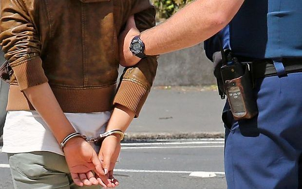 generic arrest person in handcuffs