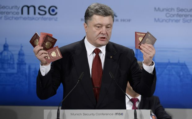 Petro Poroshenko shows passports of Russian soldiers to demonstrate the presence of Russian troops in the Ukraine.