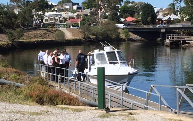 Detectives searching for body parts in a Melbourne river on Friday after a severed arm was found.