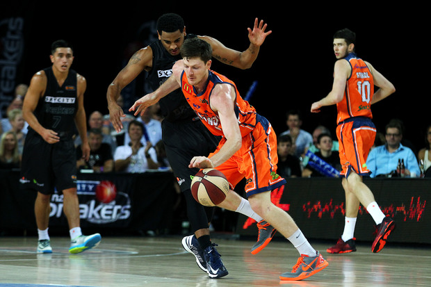 Corey Webster of the Breakers bodies up on Cameron Gliddon of the Taipans.
