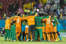 The Ivory Coast football team celebrates.