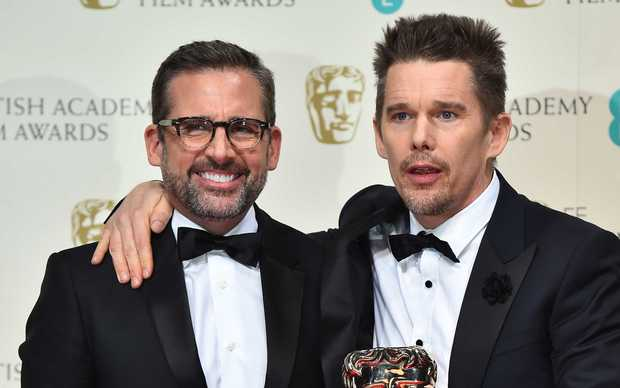 Actor Ethan Hawke, right, collects the Boyhood award on behalf of US director Richard Linklater, and poses with presenter Steve Carell.