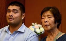 Michael Chan (L) and Helen Chan (R) - -the brother and mother of Australian on death row Andrew Chan deliver an emotional appeal to Indonesian authorities.