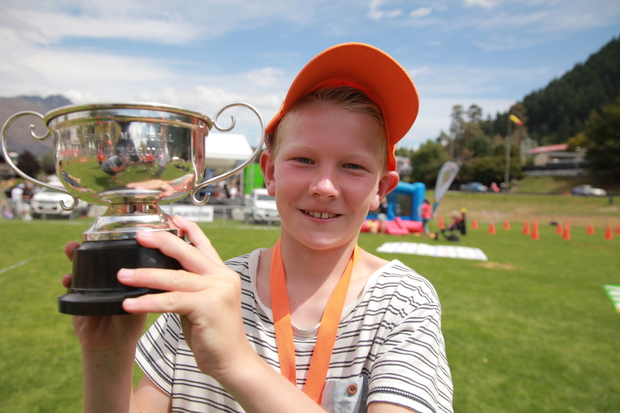 10-year-old Adam Stevens from Invercargill with the Bill Tapley Trophy for cow pat tossing