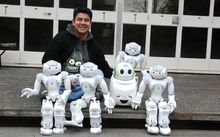 Eduardo Sandoval and some of the University of Canterbury's research robots.