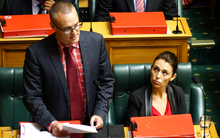 Labour MP Dr David Clark (left) and Labour MP Jacinda Ardern (right) in question time.