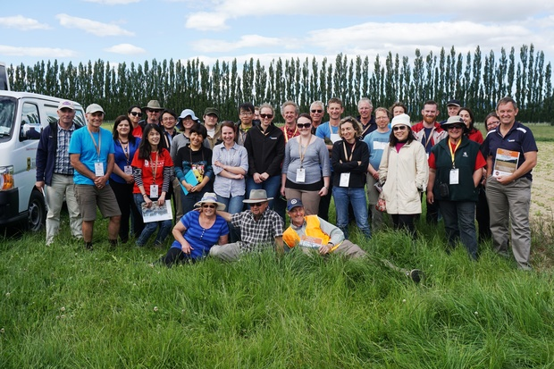 A group of soil scientists enjoying a field trip to explore volcanic soils. Dairy farmer Eric Smeith is pictured in the middle of the front row, and on the right is Waikato University soil scientist David Lowe (in high-visibility vest), who lead the trip.