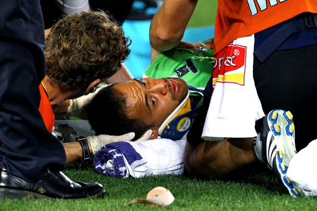The Highlanders' Buxton Popoalii suffers a head injury during a Super Rugby match.