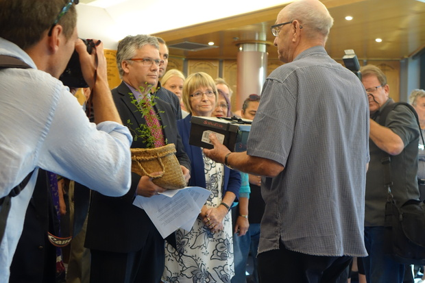 New Plymouth Mayor Andrew Judd (left) accepts a petition from Hugh Johnson which is likely to spark a referendum on the establishment of a designated seat for Maori on council.