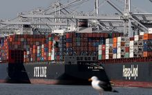Container ships sit moored at the Port of Oakland. A work slowdown at West Coast ports continues amidst long contract negotiations between Pacific Maritime Association and the International Longshore and Warehouse Union.