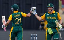 South Africa's David Miller and JP Duminy celebrates his hundred during the ICC Cricket World Cup match - South Africa v Zimbabwe at Seddon Park, Hamilton, 15 February 2015.