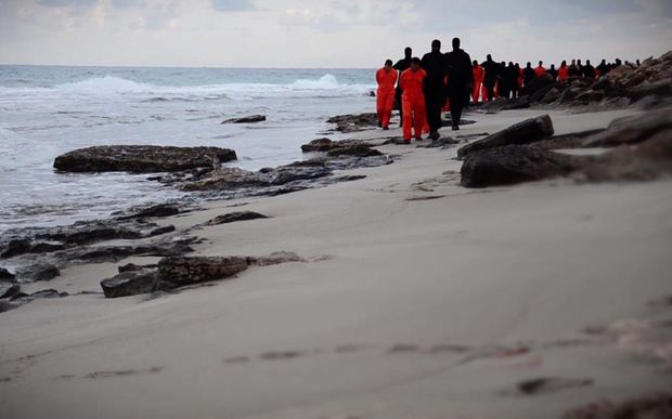 An image grab purportedly shows Islamic State fighters leading handcuffed hostages, said to be Egyptian Coptic Christians, before their alleged decapitation on a seashore near the Libyan capital of Tripoli.