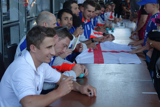 England giving autographs to fans. From left James Taylor, Ian Bell, James Treadwell, Ravi Bopara, Moeen Ali and Alex Hales.