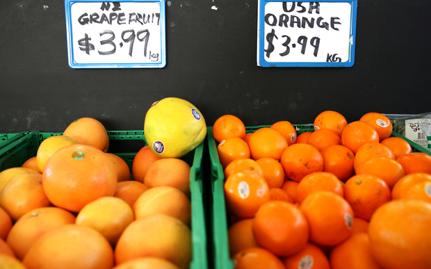 Grapefruit and orange in a fruit and vegetable store called Farmville in Grey Lynn, Auckland.