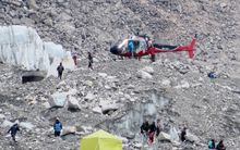 April 18, 2014: A Nepalese rescue helicopter lands at Everest Base Camp during rescue efforts following an avalanche that killed 16 Nepalese sherpas in the Khumbu icefall at the base of Mount Everest.
