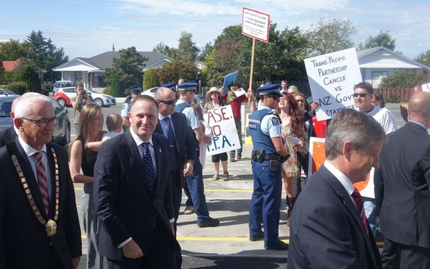 About a dozen protesters were at the opening of the Oxford Town hall , which John Key opened today.
