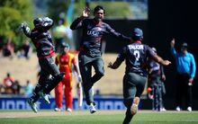 UAE bowler Amjad Javed celebrates the wicket of Hamilton Masakadza in Nelson
