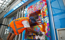 A contractor cleaning up the vandalised ATM in Ponsonby Road, Auckland.