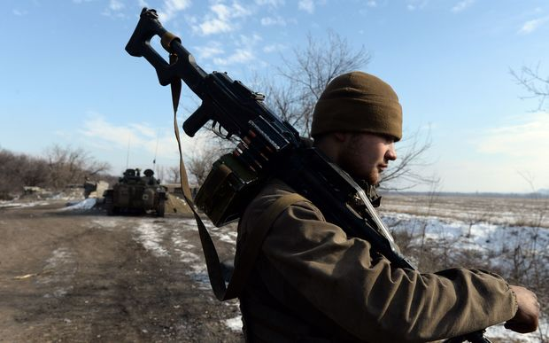A tank of pro-Russian rebels take a position outside Uglegorsk, 6km southwest of Debaltseve.