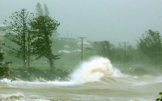 Waves crash into a breakwall after Tropical Cyclone Marcia made landfall in the coastal town of Yeppoon.