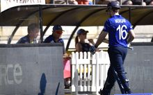 England's captain Eoin Morgan walks from the field after being caught by New Zealand's Trent Boult.