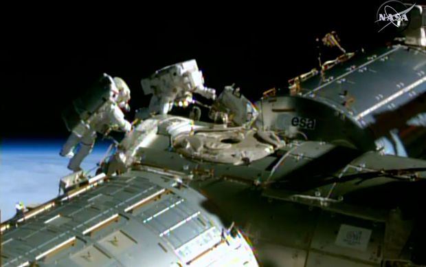 A NASA TV image shows NASA astronauts Barry Wilmore(L) and Terry Virts during a spacewalk to lay cable on the International Space Station.