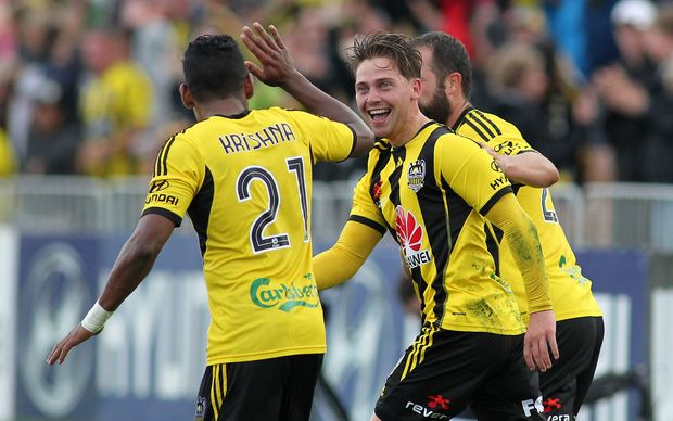 Phoenix's Jason Hicks celebrates his equalizer with Roy Krishna.