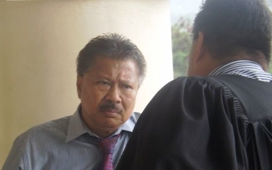 Former Samoa MP Muagututagata Peter Ah Him, convicted of forgery, speaking to his lawyer outside court.