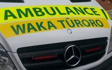 An ambulance with signage in Te Reo Māori.