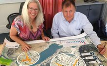 Councillor Alexa Forbes and Queenstown Lakes District Council Infrastructure Manager Dennis Mander study a map showing the new transport strategy proposals.