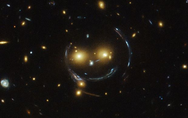 The heavens smile on us ... the galaxy cluster, SDSS J1038+4849.